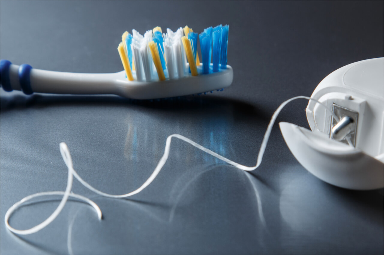 ask a dentist about proper brushing and flossing
