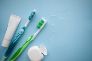 ask a dentist about how to properly brush and floss your teeth